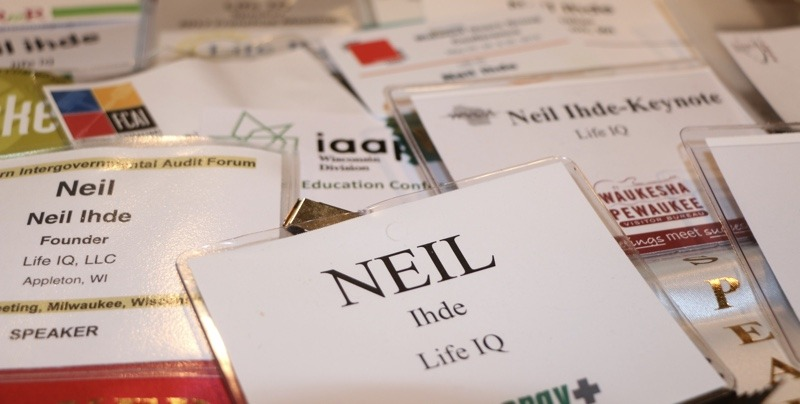 A pile of name tags all reading Neil Ihde